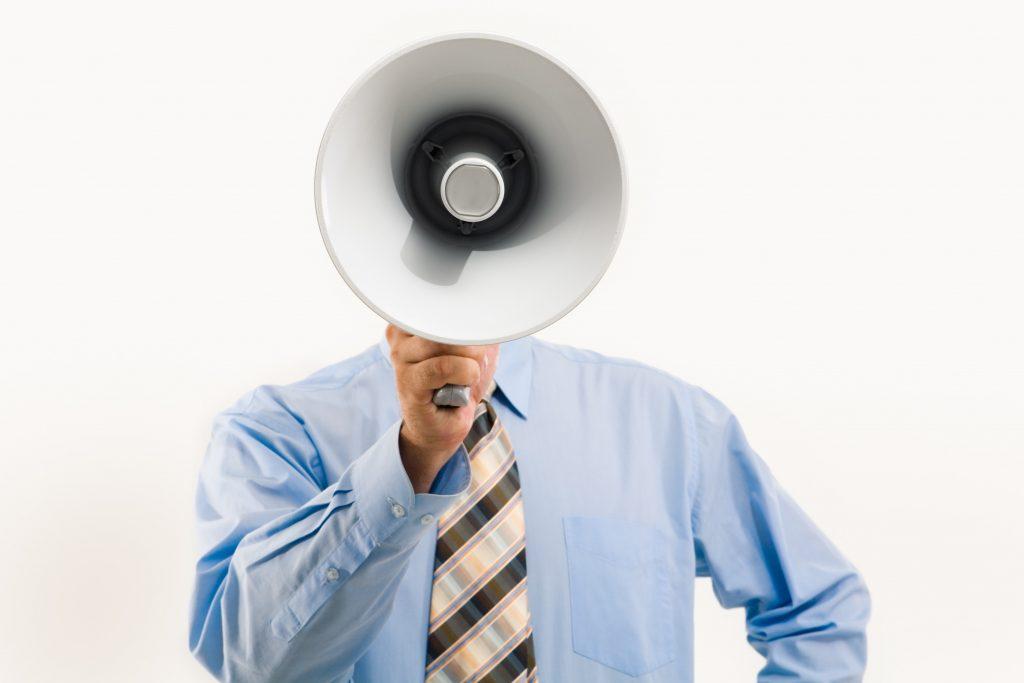 man-holding-a-megaphone-3851254
